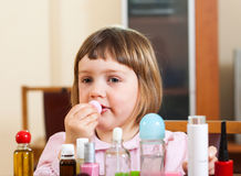 Child  painted cosmetics Stock Image