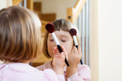 Child  painted cosmetics Royalty Free Stock Images