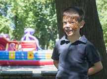 Child with painted face Stock Photography