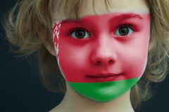 Child with a painted flag of Belarus. Portrait of a child with a painted flag of Belarus on her face, closeup Royalty Free Stock Image
