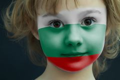 Child with a painted flag of Bulgaria. Portrait of a child with a painted flag of Bulgaria on her face, closeup Royalty Free Stock Images