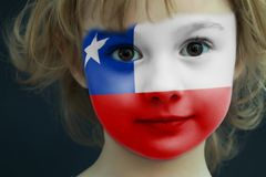 Child with a painted flag of Chile. Portrait of a child with a painted flag of Chile on her face, closeup Royalty Free Stock Image
