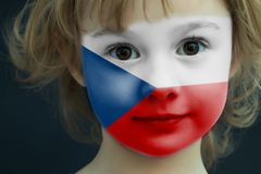 Child with a painted flag of Czech Republic. Portrait of a child with a painted flag of Czech Republic on her face, closeup Royalty Free Stock Images