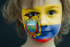 Child with a painted flag of Ecuador. Portrait of a child with a painted flag of Ecuador on her face, closeup Royalty Free Stock Image