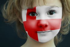 Child with a painted flag of England. Portrait of a child with a painted flag of England on her face, closeup Stock Image
