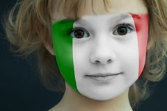 Child with a painted flag of Italy. Portrait of a child with a painted flag of Italy on her face, closeup Royalty Free Stock Image