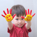 Child with painted hands Royalty Free Stock Images
