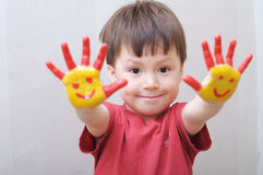 Child with painted hands Royalty Free Stock Image
