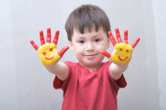 Child with painted hands Stock Images