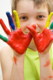 Child with painted hands Royalty Free Stock Photos