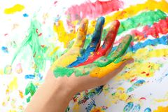 Child with painted palm on color background stock photography