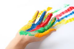 Child with painted palm on white background. Closeup royalty free stock image