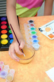 Child is painting. A little girl is painting stock images