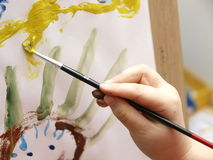 Child Painting. A child´s hand painting with a paintbrush Royalty Free Stock Images