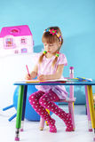 Child painting. In her nursery at home Royalty Free Stock Images