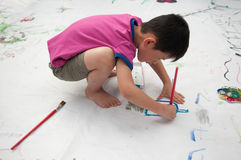 The child is painting Stock Images