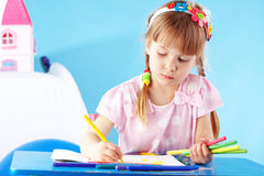 Child painting. In her nursery at home Stock Photography