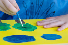 Child is painting. Child hands painting close up photo Royalty Free Stock Photography