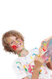 Child painting. Happy child or kid painting with paint and brush Stock Images