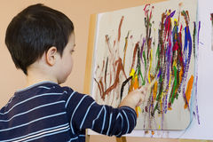 Child painting. A colorful abstract picture with a brush and poster paint colors Royalty Free Stock Photography