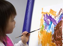 Child Painting 3. A young preschool girl paints a picture stock photo