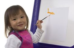 Child Painting 6. A young preschool girl paints a colorful picture royalty free stock photography