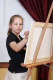 Child painting. One child in black painting on a canvas Stock Photos