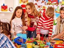 Child painting at art school stock image