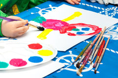 Child painting with brush Stock Photography