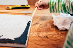 Child painting canvas. In art class royalty free stock photography
