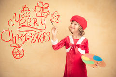 Child painting Christmas decorations Royalty Free Stock Photo