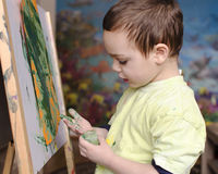 Child painting with colors Royalty Free Stock Photography