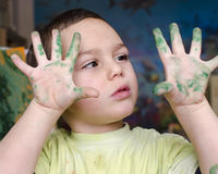 Child painting with colors Royalty Free Stock Photos