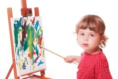 Child painting on easel Stock Photography