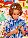 Child painting at easel Stock Images