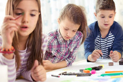 Child painting at easel in school Royalty Free Stock Photos