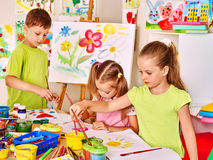 Child painting at easel Stock Photography