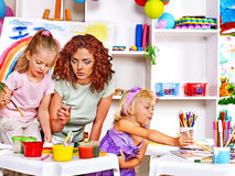 Child painting at easel. Stock Image