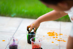 Child painting easter egg Royalty Free Stock Photos