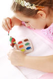 Child painting Easter eggs. Cute little girl painting Easter eggs Stock Photo