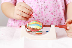 Child painting Easter eggs Stock Photography