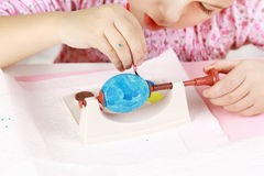 Child painting Easter eggs Royalty Free Stock Images