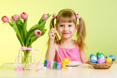 Child painting Easter eggs Royalty Free Stock Image