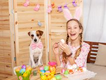 Child painting Easter eggs Stock Image