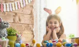 Child painting eggs royalty free stock photography