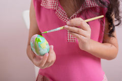Child is painting fake egg Royalty Free Stock Photo