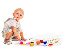 Child painting by finger paint. Royalty Free Stock Photography