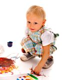 Child painting by finger paint Stock Images