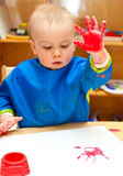 Child painting with hand Stock Images