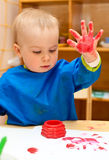 Child painting with hand Stock Photos